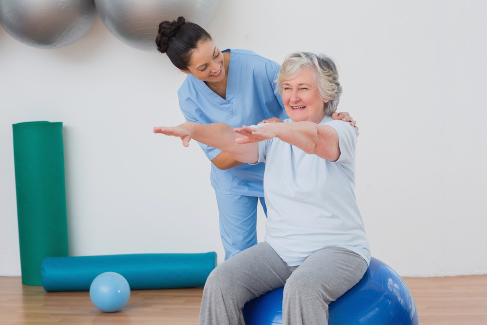 Fall Prevention Physical Therapist Working with Patient on Balance